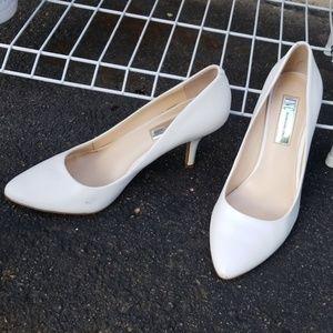 White pumps. Dress shoes. Hills